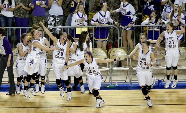 GIRLS HIGH SCHOOL BASKETBALL / STATE TOURNAMENT / CELEBRATION: Okarche celebrates as they win the Class A girls state championship game between Okarche and Cheyenne/Reydon in the State Fair Arena at State Fair Park in Oklahoma City, Saturday, March 2, 2013. Photo by Bryan Terry, The Oklahoman