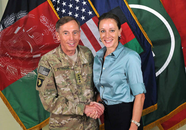 "FILE - This July 13, 2011, file photo, provided by the International Security Assistance Force's Flickr website shows the former Commander of International Security Assistance Force and U.S. Forces-Afghanistan Gen. Davis Petraeus, left, shaking hands with Paula Broadwell, co-author of his biography ""All In: The Education of General David Petraeus."" A person close to Broadwell says she deeply regrets the damage that�s been done from her affair with now-ex-CIA chief Petraeus, and she is trying to repair that and move forward. The friend spoke on condition of anonymity because he was not authorized to speak publicly. (AP Photo/ISAF, File)"