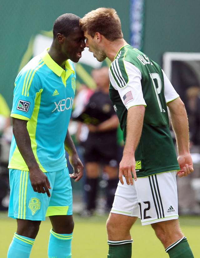 FILE - This June 24, 2012 file photo shows Seattle Sounders' Eddie Johnson, left, and Portland Timbers' David Horst (12) going head-to-head after a foul in the second half during an MLS soccer game in Portland, Ore. On a day normally reserved for American football, the Sounders will visit the Timbers on Saturday, Sept. 15, 2012, as the Cascadia Cup rivalry plays out on a national stage. (AP Photo/Rick Bowmer, File)