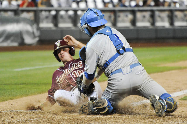 UCLA catcher Tyler Heineman tags out Florida State's Seth Miller in the eighth inning of an NCAA College World Series elimination baseball game in Omaha, Neb., Tuesday, June 19, 2012. Florida State beat UCLA 4-1. (AP Photo/Dave Weaver)