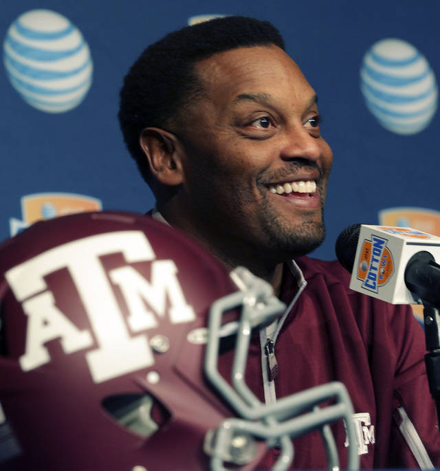 Texas A&M head coach Kevin Sumlin smiles as he speaks during media day for the Cotton Bowl NCAA college football game at Cowboys Stadium, Sunday, Dec. 30, 2012, in Arlington, Texas. Texas A&M is scheduled to play Oklahoma on Jan. 4, 2013. (AP Photo/LM Otero) ORG XMIT: TXMO107