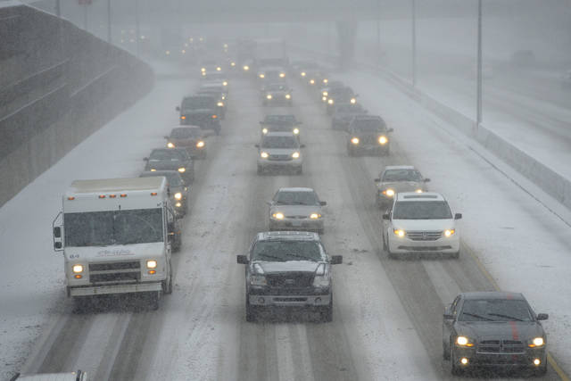 Cars make their way slowly on the eastbound lanes of Interstate 696 near Central Park Boulevard in Southfield, Mich., Wednesday afternoon, Dec. 26, 2012  (AP Photo/The Detroit News, David Guralnick)