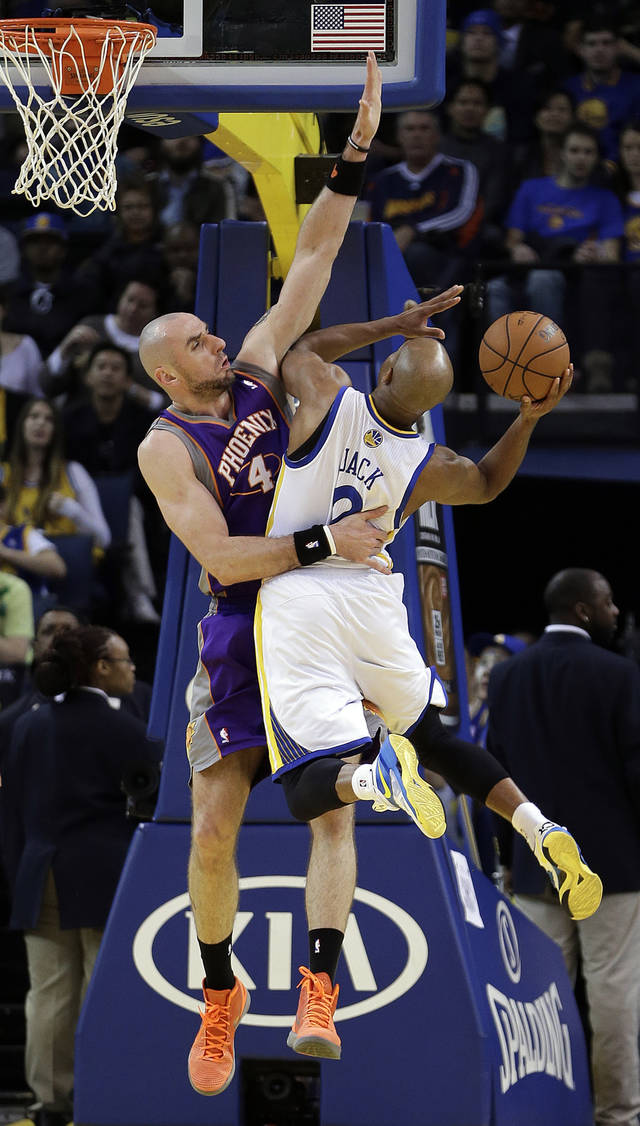 Golden State Warriors' Jarrett Jack (2) drives against Phoenix Suns' Marcin Gortat, left, during the first half of an NBA basketball game Saturday, Feb. 2, 2013, in Oakland, Calif. (AP Photo/Ben Margot)