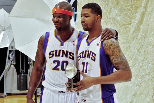 Phoenix Suns' Markieff Morris (11) and Jermaine O'Neal (20) pose with a vintage camera during the their NBA basketball media day, Monday, Oct. 1, 2012, in Phoenix. (AP Photo/Matt York)