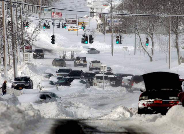 Stranded vehicles litter the roadway along Route 25 in Lake Grove, N.Y., Saturday, Feb. 9, 2013. Many people abandoned their vehicles along Long Island roadways after they became stuck in the rapidly falling snow. Frist responders rescued a number of people from stranded cars, some having spent the night in frigid temperatures.  (AP Photo/Newsday, Ed Betz) NYC LOCALS OUT; NO SALES ORG XMIT: NYANE504