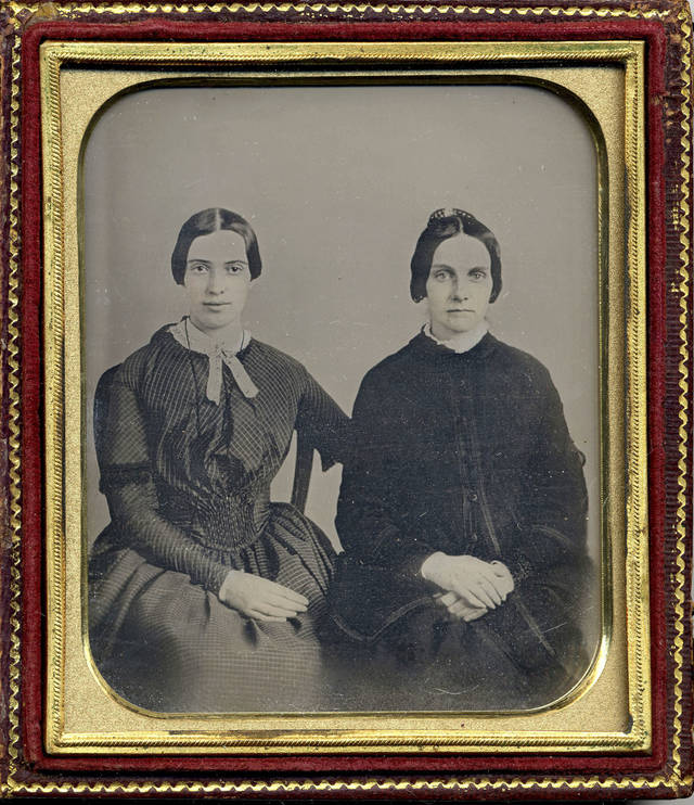 This photo released by Amherst College Archives and Special Collections, and the Emily Dickinson Museum, in Amherst, Mass., shows a copy of a circa 1860 daguerreotype purported to show a 30-year-old Emily Dickinson, left, with her friend Kate Scott Turner. The image was displayed during the August 2012 Emily Dickinson International Society conference held at Case Western Reserve University in Cleveland.  AP Photo/Amherst College Archives and Special Collections, and the Emily Dickinson Museum <strong></strong>