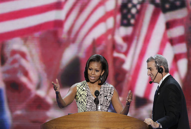 First lady Michelle Obama looks over the podium Monday during a sound check at the Democratic National Convention in Charlotte, N.C. AP PHOTO