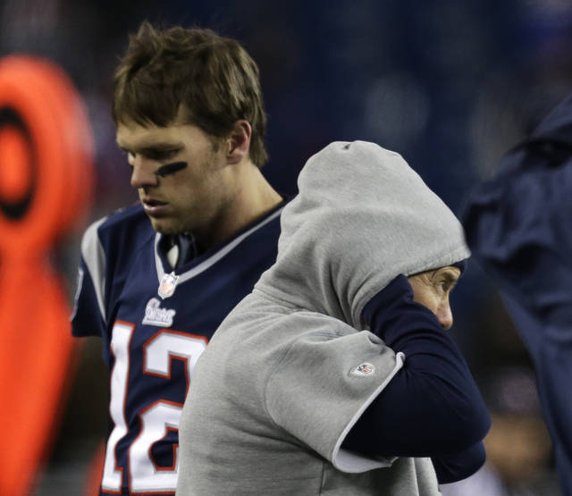 New England Patriots quarterback Tom Brady (12) walks past Patriots head coach Bill Belichick after throwing an interception during the second half of the NFL football AFC Championship football game against the Baltimore Ravens in Foxborough, Mass., Sunday, Jan. 20, 2013. The Ravens won 28-13 to advance to Super Bowl XLVII. (AP Photo/Steven Senne)