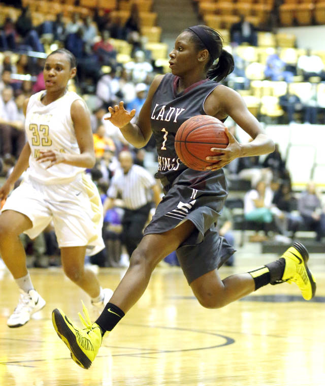 Northeast Lanesia Williams drives to the basket during the girl's basketball game between Northeast and Midwest City at the Midwest City/Del City Holiday Invitational,  Saturday,Dec. 29, 2012. Photo by Sarah Phipps, The Oklahoman