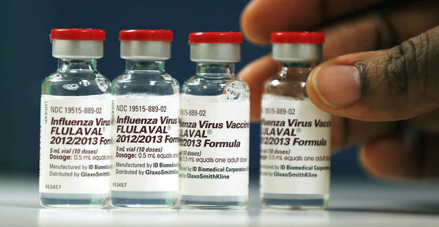 Vials of flu vaccine are displayed at the Whittier Street Health Center in Boston, Mass., Wednesday, Jan. 9, 2013. Boston declared a public health emergency Wednesday as the city tried to deal with a harsh flu season and the state reported 18 flu-related deaths so far. (AP Photo/Charles Krupa)