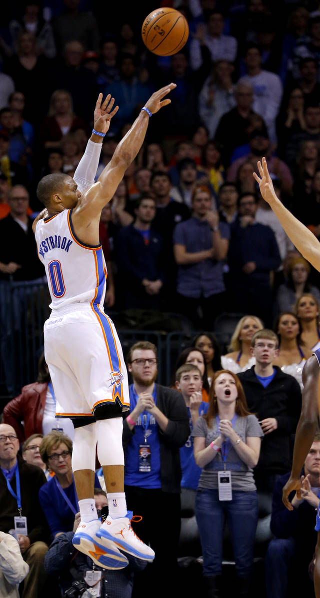 Oklahoma City's Russell Westbrook (0) shoots a basket during an NBA basketball game between the Oklahoma City Thunder and the Dallas Mavericks at Chesapeake Energy Arena in Oklahoma City, Thursday, Dec. 27, 2012.  Oklahoma City won 111-105. Photo by Bryan Terry, The Oklahoman