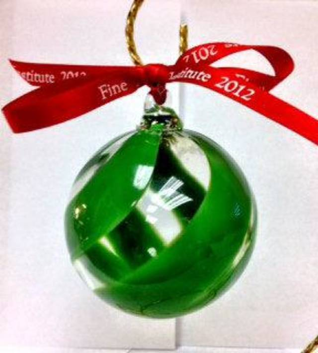 Fine Arts Institute of Edmond is offering a holiday Christmas ornament for the eighth year. This year�s commemorative glass ornament is selling for $25. PHOTO PROVIDED