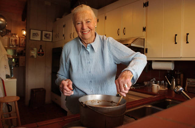 "FILE - This May 27, 2004 file photo shows Marion Cunningham, a venerated figure in the food world, at home in Walnut Creek, Calif. Cunningham, the home-cooking champion whose legacy can be found in the food-spattered pages of ""Fannie Farmer"" cookbooks in kitchens across America, died of complications from Alzheimer's disease, a family friend told the San Francisco Chronicle. She was 90. (AP Photo/Ben Margot, file)"