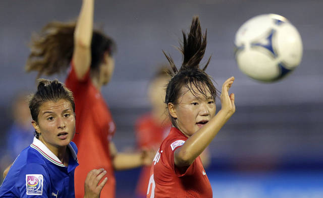 Italy's Luisa Pugnali, left, and South Korea's Jang Selgi watch a ball during their soccer match of the Women's U20 World Cup at Komaba stadium in Saitama, Japan, Wednesday, Aug. 22, 2012. (AP Photo/Shizuo Kambayashi)