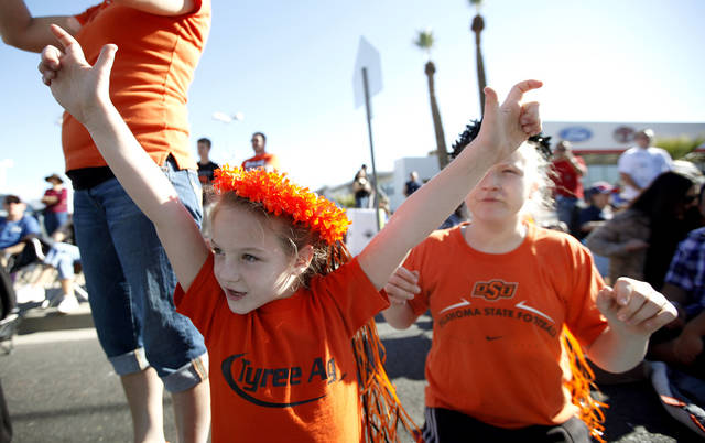 Carson Tyree, 7, and Payton Tyree, 11, of Kansas City cheer during the Fiesta Bowl parade in Phoenix, Ariz., Saturday, Dec. 31, 2011. Photo by Sarah Phipps, The Oklahoman