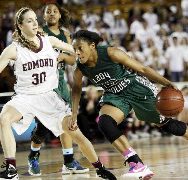 Edmond Santa Fe's Courtney Walker (23) drives the ball against Edmond Memorial's Toree Thompson (30) during the Class 6A girls high school basketball state tournament championship game between Edmond Santa Fe and Edmond Memorial at the Mabee Center in Tulsa, Okla., Saturday, March 10, 2012. Santa Fe won, 44-41. Photo by Nate Billings, The Oklahoman