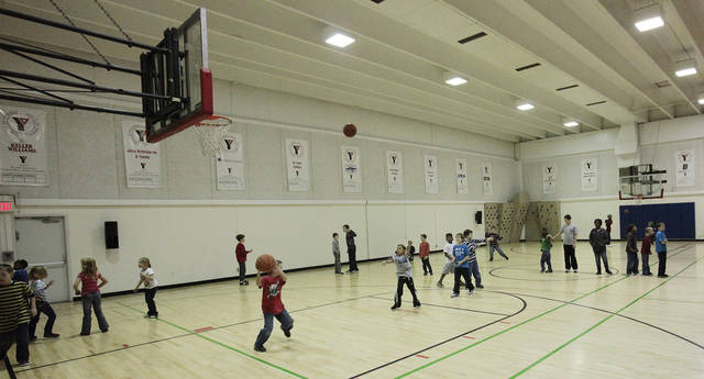 Children in the Before and After School Care program play basketball n the gym at the YMCA in Edmond, Thursday, December 22 , 2011.  Photo by David McDaniel, The Oklahoman