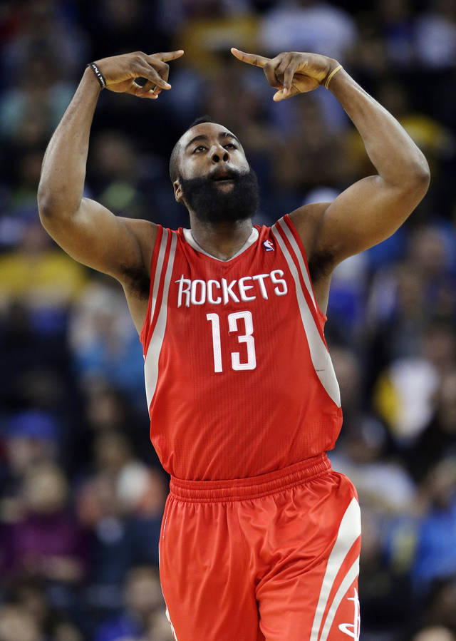 Houston Rockets' James Harden (13) reacts after making a three-point basket against the Golden State Warriors during the second half of an NBA basketball game in Oakland, Calif., Tuesday, Feb. 12, 2013. Houston won 116-107.  (AP Photo/Marcio Jose Sanchez)