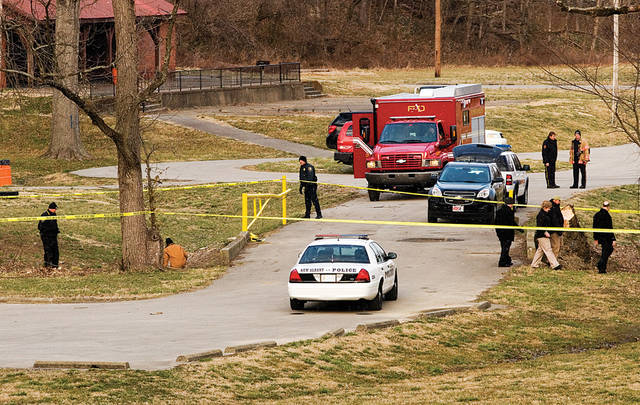 Emergency officials work the scene of a homicide investigation along Falling Run Creek in Binford Park in New Albany on Wednesday evening, March 14, 2013. New Albany police are conducting a homicide investigation after the bodies of a woman and two children were found in Falling Run Creek in Binford Park Wednesday. Police said investigators are treating the deaths as homicides despite the lack of any obvious signs of foul play. (AP Photo/The Tribune, Christopher Fryer)
