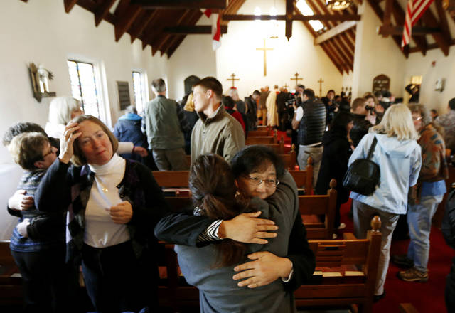 People embrace each other during a service in honor of the victims who died a day earlier when a gunman open fire at Sandy Hook Elementary School in Newtown, Conn., as people gathered at St. John's Episcopal Church , Saturday, Dec. 15, 2012, in the Sandy Hook village of Newtown, Conn.  The massacre of 26 children and adults at Sandy Hook Elementary school elicited horror and soul-searching around the world even as it raised more basic questions about why the gunman, 20-year-old Adam Lanza, would have been driven to such a crime and how he chose his victims. (AP Photo/Julio Cortez) ORG XMIT: CTJC118