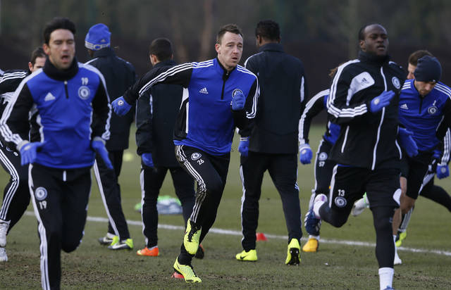 Chelsea's John Terry, centre, runs with teammates,  during a training session at Chelsea's training ground in Cobham, Surrey, England,  Wednesday, Feb. 20, 2013. Chelsea will play Sparta Prague in a  Europa League round of 32 second leg soccer match at Stamford Bridge Stadium in London on Thursday. (AP Photo/Kirsty Wigglesworth)