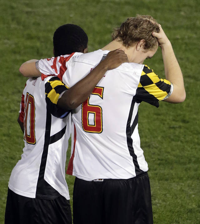 Maryland's Helge Leikvang reacts with teammate Sunny Jane , left, after missing a penalty kick against Georgetown at the end of a NCAA College Cup men's championship semifinal soccer match at Regions Park, Friday, Dec. 7, 2012, in Hoover, Ala. (AP Photo/Dave Martin)