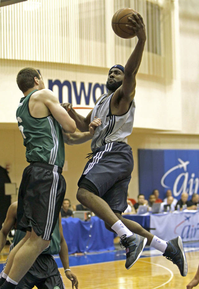 Oklahoma City Thunder's James Harden, right, drives in for a shot over Boston Celtics' Art Parakhouski during the second half of an NBA summer league basketball game in Orlando, Fla., Monday, July 5, 2010.(AP Photo/John Raoux) ORG XMIT: FLJR110