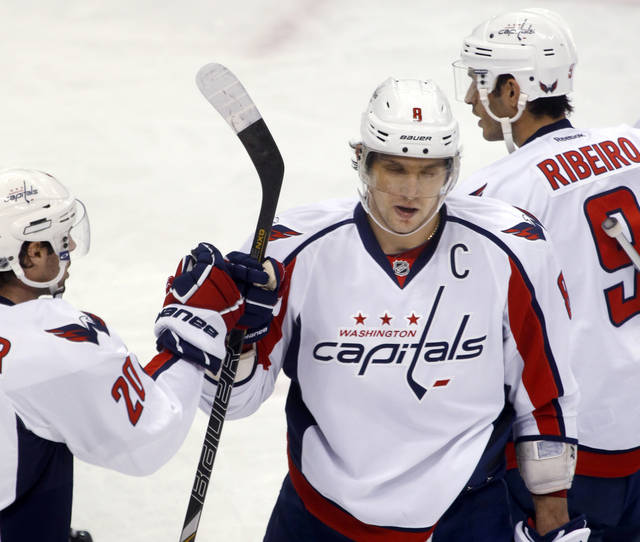 Washington Capitals' Alex Ovechkin, center, is greeted by teammates Troy Brouwer (20) and Mike Ribeiro (9) after scoring in the third period of an NHL hockey game against the Pittsburgh Penguins on Thursday, Feb. 7, 2013, in Pittsburgh. The Penguins won 5-2. (AP Photo/Keith Srakocic)