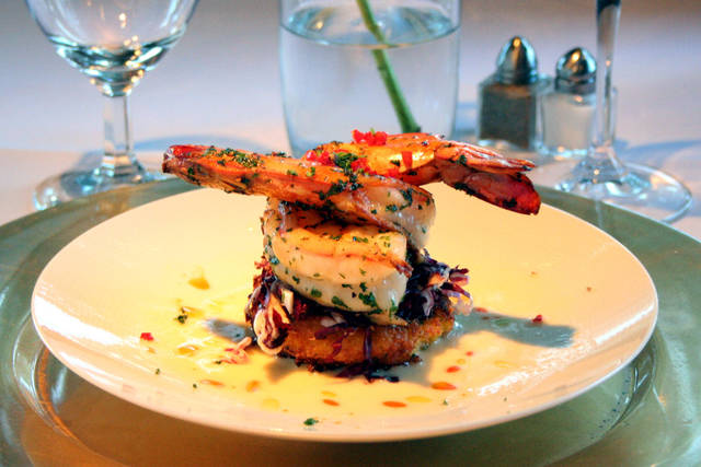 Seared Gulf Shrimp on Christian Cheddar corn cake with Beurre Blanc.