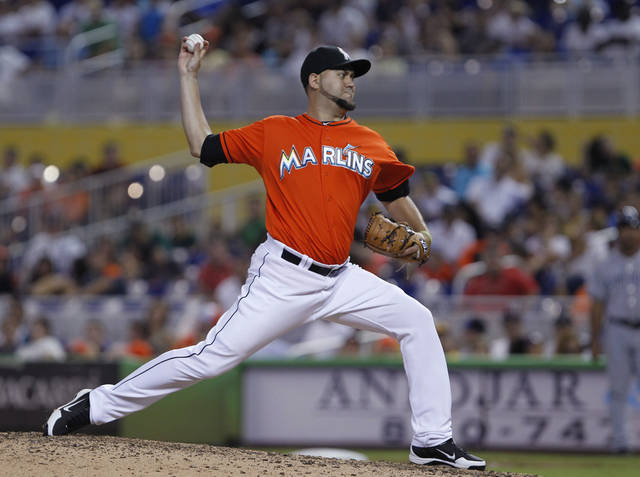 In this Sunday, July 29, 2012, photo, Miami Marlins' Edward Mujica delivers a pitch during a baseball game against the San Diego Padres in Miami. The St. Louis Cardinals acquired bullpen help at the trade deadline, getting right-hander Mujica from the Marlins for 2010 first-round draft pick Zack Cox. (AP Photo/Wilfredo Lee)