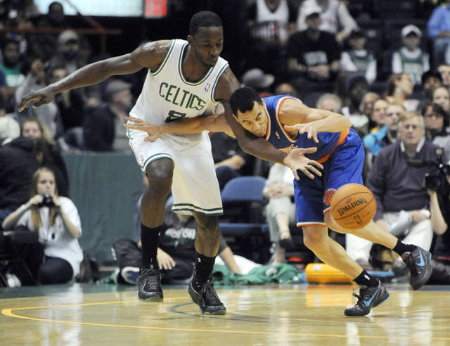 Boston Celtics' Jeff Green (8), knocks the ball away from New York Knicks' Pablo Prigiono, right, during the first half of an NBA preseason game in Albany, N.Y. on Saturday, Oct. 20, 2012. (AP Photo/Tim Roske)
