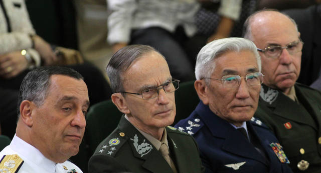 Navy Commander Julio Soares Bueno, left, Commander of the Army Enzo Martins, second from left, Commander of the Air Force Juniti Saito, third from left, and the Commander of the Armed Forces Jose Carlos de Nardi attend a ceremony at which Brazil's President Dilma Rousseff signed a law establishing a truth commission at Planalto presidential palace in Brasilia, Brazil, Friday Nov. 18, 2011. Rousseff established the truth commission to investigate human rights abuses by the military regime that ruled Brazil from 1964 to 1985. However, the commission's recommendations won't result in any prosecutions as long as the country's 1979 amnesty law remains intact. Unlike Argentina, Chile and Uruguay, which also had repressive military regimes, Brazil has never punished military officials accused of human rights abuses. (AP Photo/Eraldo Peres)
