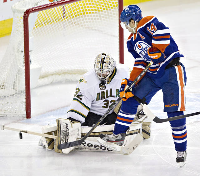 Dallas Stars goalie Kari Lehtonen makes the save on Edmonton Oilers' Jordan Eberle (14) during second period NHL hockey action in Edmonton, Alberta, on Tuesday Feb. 12, 2013. (AP Photo/The Canadian Press, Jason Franson)