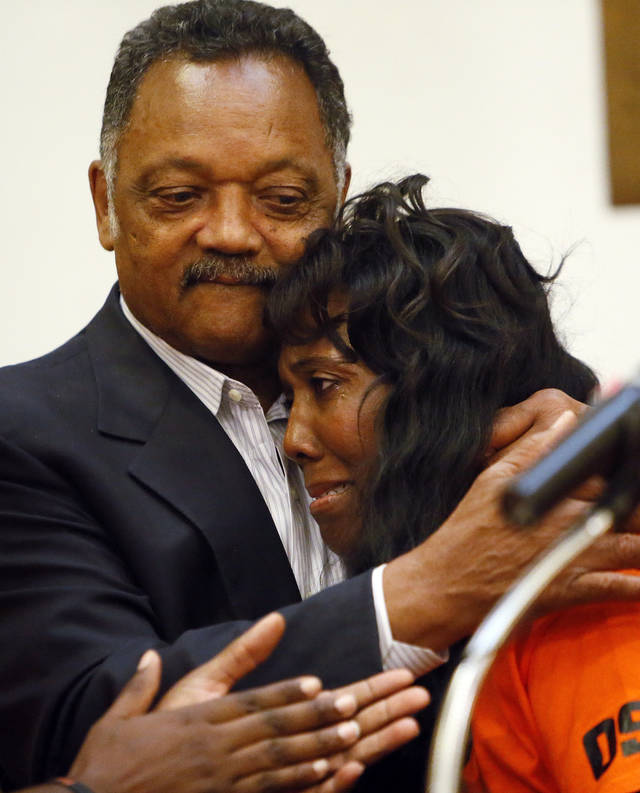 Rev. Jesse Jackson embraces Alice Williams, mother of Darrell Williams, during a rally in support of Darrell Williams at Mt. Zion Baptist Church in Stillwater, Okla., Thursday, Aug. 23, 2012. Williams, a suspended Oklahoma State basketball player, was found guilty on two counts of rape by instrumentation and one count of sexual battery after an incident at a house party. Photo by Nate Billings, The Oklahoman