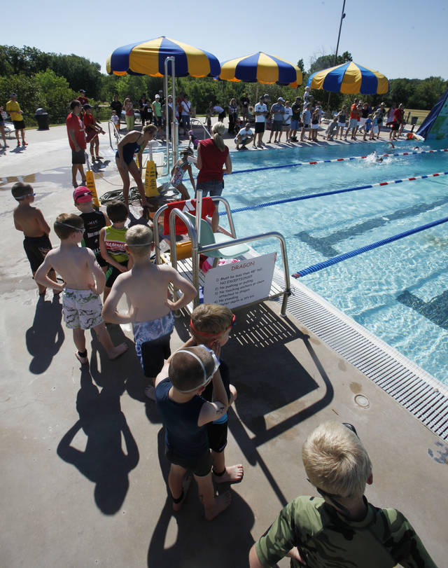 7-8 year olds compete in the swimming leg of a youth triathlon hosted by the Edmond YMCA at Hafer Park and Pelican Bay in Edmond, OK, Saturday, July 21, 2012,  By Paul Hellstern, The Oklahoman