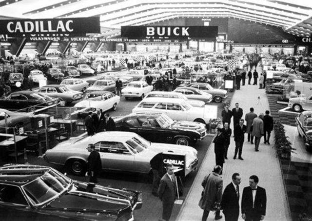 FILE - This Jan. 16, 1969 file photo shows exhibitors at the Brussels Car Show held at the Plais Du Centenaire, in Brussels.  General Motors survived wars, strikes and the Great Depression churning out Chevys, Cadillacs and other vehicles that often defined their owners' status in life. But less than a year into its second 100 years, it's coming to the end of a road, ushered by the government into bankruptcy protection. (AP Photo/File)