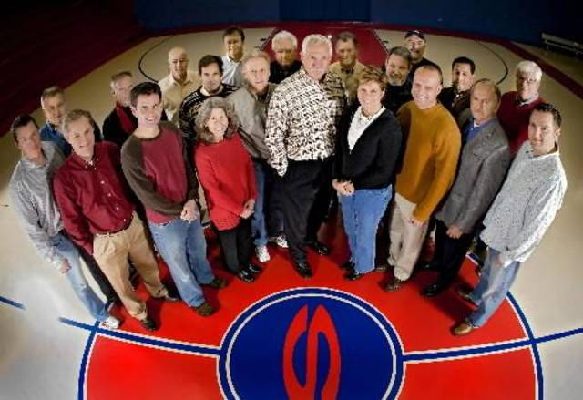 Kent  Bradford, center, and his host of volunteers pose for a photo at the Satellite Gym on Tuesday, Dec. 23, 2008, in Oklahoma City, Okla.  Bradford and the volunteers have been operating this hidden Oklahoma City gem for the last decade. Photo by CHRIS LANDSBERGER, THE OKLAHOMAN