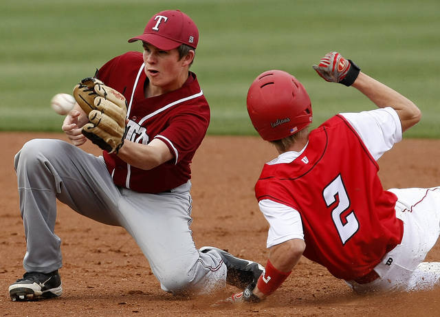 Tuttle's Conner Litterell waits for the ball as Comanche's Zach Young slides to second base in the first inning of their high school baseball game at RedHawks Field at Bricktown in Oklahoma City, Tuesday, March 27, 2012. Photo by Bryan Terry