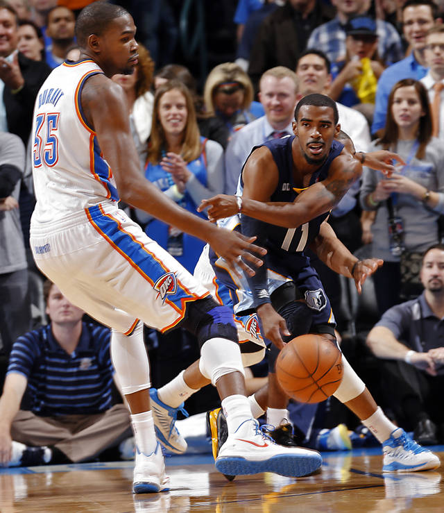 Memphis' Mike Conley Jr. (11)  passes around Oklahoma City's Kevin Durant (35) during the NBA basketball game between the Oklahoma City Thunder and the Memphis Grizzlies at Chesapeake Energy Arena on Wednesday, Nov. 14, 2012, in Oklahoma City, Okla.   Photo by Chris Landsberger, The Oklahoman