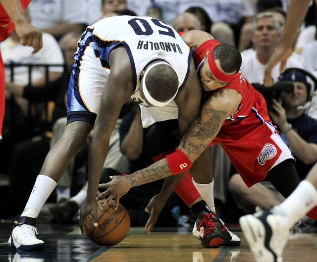 Memphis Grizzlies forward Zach Randolph (50) and Los Angeles Clippers forward Kenyon Martin, right, battle for the ball in the first half of Game 7 in a first-round NBA basketball playoff series on Sunday, May 13, 2012, in Memphis, Tenn. (AP Photo/Mark Humphrey)