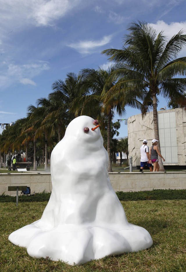 "A melting-snowman sculpture titled ""Bonhomme de Neige,"" by artist Pierre Ardouvin is shown on display as part of Art Basel Miami Beach, Wednesday, Dec. 5, 2012 in Miami Beach, Fla. Art Basel Miami Beach and about two dozen other independent art fairs open Thursday. Tens of thousands of people are expected through Sunday at the fairs throughout Miami and South Beach. (AP Photo/Wilfredo Lee)"