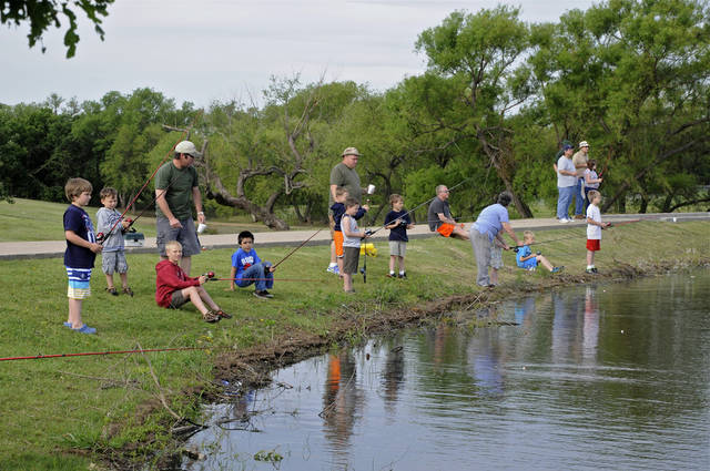 Hooked on Fishing for young people fishing at South Lakes fishing pond, SW 119 and Meridian. Starts at 8 a.m., ends about 10 a.m. For more info on Friday call 632-2240, this is a police athletic league function. Officer at scene on Saturday will be Sgt. Erik Joyner, 250-7921. Photo by M. Tim Blake, for The Oklahoman