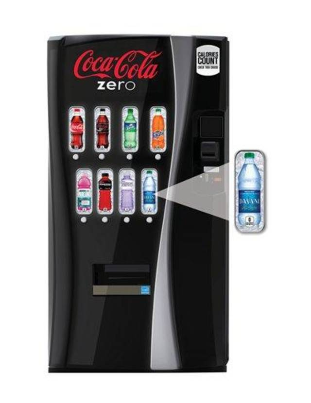 """This undated image provided by Coca-Cola shows a new soda vending machine the company announced Monday, Oct. 8, 2012, that they plan to roll out. The new vending machines are a response to the intensifying criticism over sugary sodas and will let customers see the calorie counts on selection buttons, and will urge consumers to choose less sugary alternatives with messages such as """"Try a Low-Calorie Beverage."""" (AP Photo/Coca-Cola )"""
