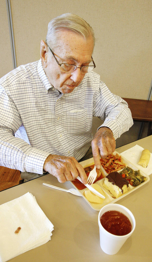 Stan Noxon eats lunch Tuesday at the Edmond Senior Center.