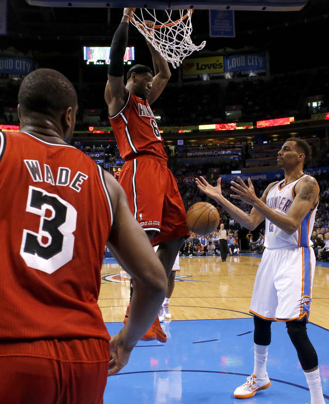 Miami's LeBron James (6) dunks the ball beside Oklahoma City's Thabo Sefolosha (2) during an NBA basketball game between the Oklahoma City Thunder and the Miami Heat at Chesapeake Energy Arena in Oklahoma City, Thursday, Feb. 15, 2013. Photo by Bryan Terry, The Oklahoman