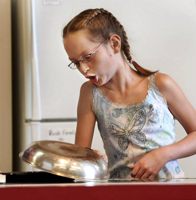 Sadie Milleson, 10, dumps a pancake from her skillet onto a plate while competing in the Shawnee Mills&#039;  Kids&#039; Pancakes, Flapjacks and Griddle Cakes Contest at the Oklahoma State Fair on Saturday, Sep. 22, 2012. The event was held in the Creative Arts Building. Milleson is a fifth grade student at Christian Heritage Academy. Photo by Jim Beckel, The Oklahoman.