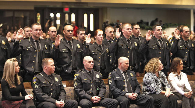 Oklahoma City Police Department graduates take the oath of office Thursday during their graduation ceremony at First United Methodist Church. The department graduated 38 police recruits in the ceremony. See more photos on Page 14A.  PHOTO BY DAVID MCDANIEL, The Oklahoman