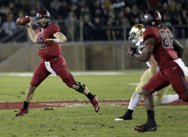 Stanford quarterback Andrew Luck (12) passes to wide receiver Ty Montgomery (88) in the first quarter against Notre Dame in an NCAA college football game in Stanford, Calif., Saturday, Nov. 26, 2011. (AP Photo/Paul Sakuma) ORG XMIT: CAPS104
