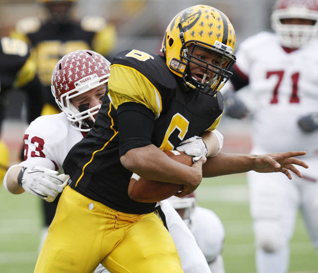 Lawton MacArthur's Quinton Paras (6) breaks away from Tyler Day (53) of Ardmore on the way to a touchdown during a high school football playoff Class 5A semifinal game between Lawton MacArthur and Ardmore in Yukon, Okla., Saturday, Nov. 26, 2011. Photo by Nate Billings, The Oklahoman