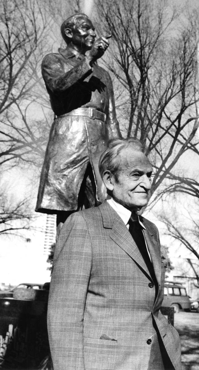 """Stanley Draper stands in front of statue dedicated in his honor Wednesday (11/27/74)."" Staff photo by Joe Miller taken 11/27/74; photo ran in the 11/28/74 Daily Oklahoman. Stanley Draper passed away on 1/18/76."